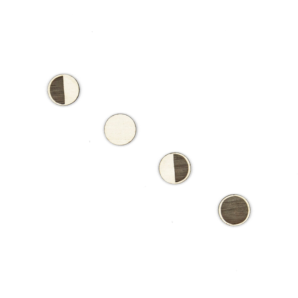 Four round wooden button earrings painted white according to the moon phases: crescent, full, declining and new moon.