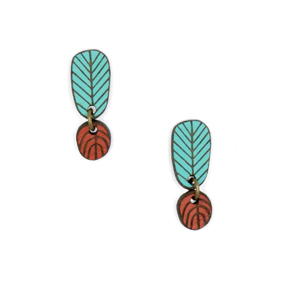 Blue and red wooden stud earrings, made up of two pieces joined with a ring that symbolize the roots and branches of a tree.