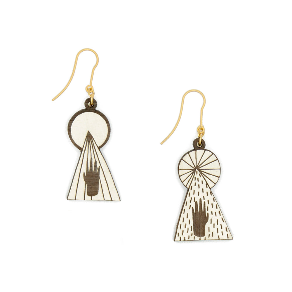 Earrings that symbolize a hand touching the light, hand painted in white, with stripes and dots that show the wood and with a golden hook. Handmade in Barcelona.