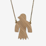 Back of the Flying Bird wooden necklace, where we can see the walnut wood and the chain in old gold color.