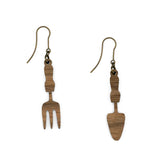 Backside of Fork Spade earrings, where you can see the laser cut wood and old gold colored metal of the hooks.