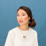 Model wearing the Flower in a Jug necklace and Wild Carrot earrings, from the COUNTRY LIFE collection by Materiarica.