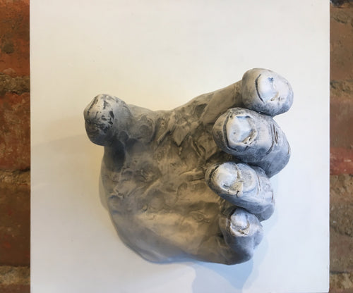 Ceramic hand on wall