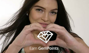 Female model making a heart with her hands, with the Gem Points logo in the center of the heart.