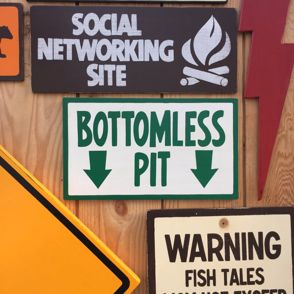 "The Simpsons ""Bottomless Pit"" Sign 
