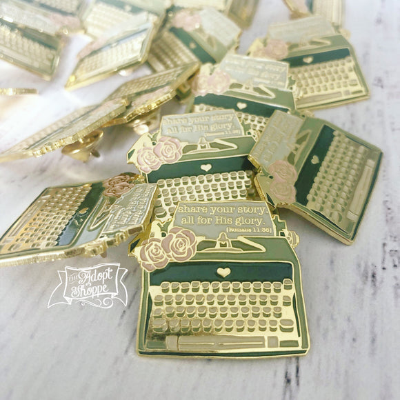 share your story - all for His glory (Romans 11:36) typewriter soft enamel pin (gold)