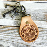 she gave herself grace because she knew He was strong in her weakness (2 Corinthians 12:9) leather key fob ring (camel/natural)