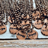 tiny hand-stamped copper disc necklace