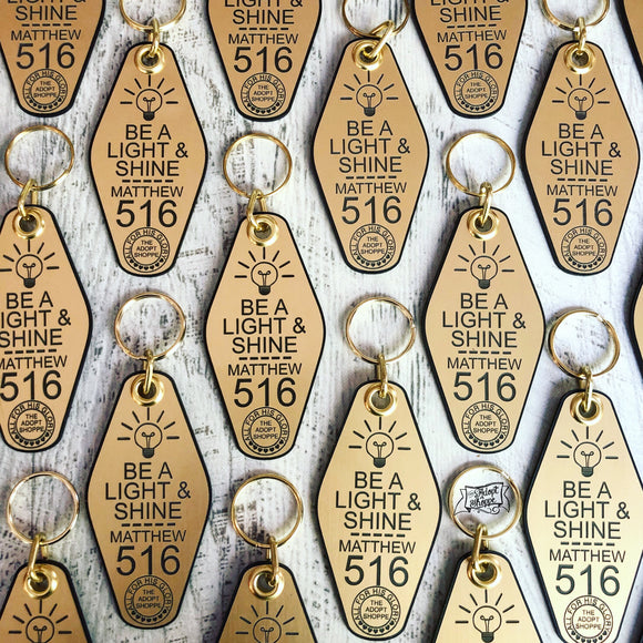 be a light and shine lightbulb gold retro motel key tag fob