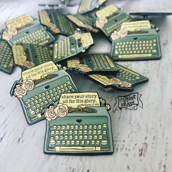 share your story - all for His glory (Romans 11:36) typewriter soft enamel pin (black)