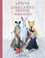 Luna Lapin and Friends book on wooden background