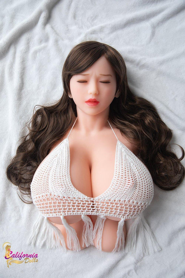 Eye closed sex doll with long brunette hair