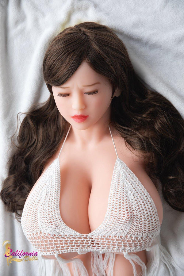 Sex doll with long brunette hair.