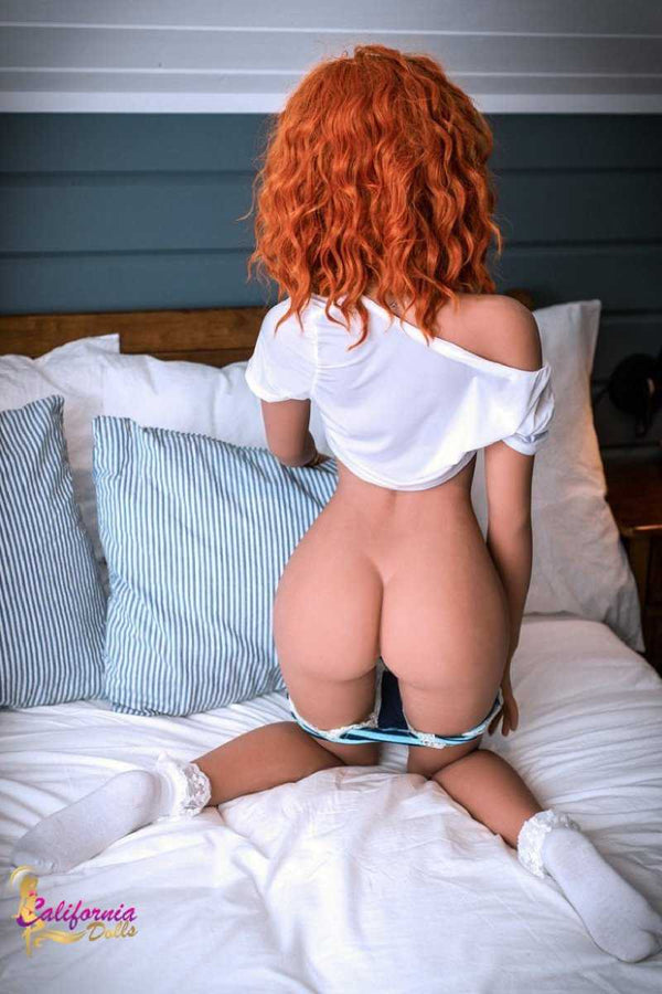 Redhead sex doll with little heart shaped butt.