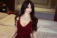 Irresistible Sex Doll Sara Sexy Red Dress Showing Her Cleavage