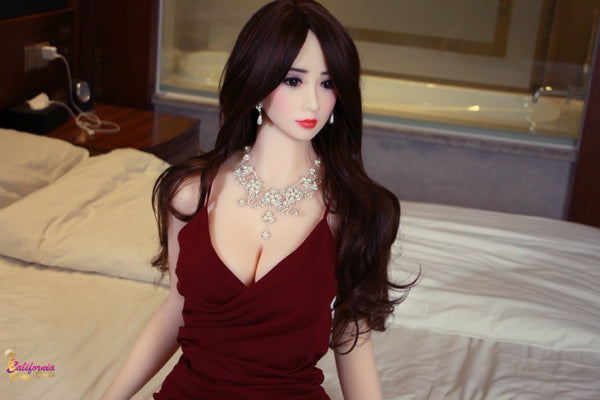 Pretty red lips on sex doll.