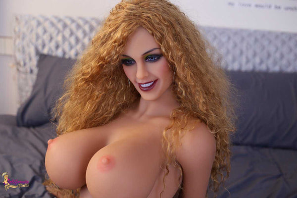 Redhead sex doll with great round perky boobs.