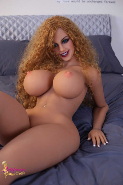 Lavish Red Head Sex Doll Naked in a Bed Showing Her Breast and Body