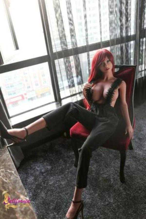 Tall sex doll with waist length red hair.