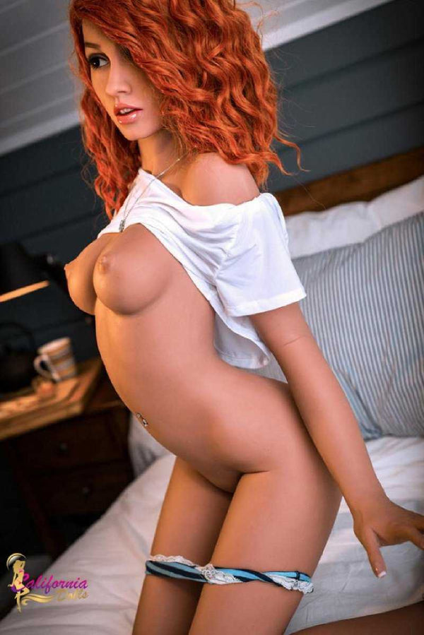 Redhead sex doll with youthful perky breast.