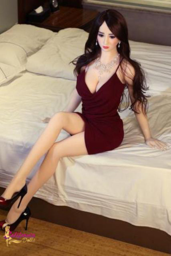 Classie sex doll wearing short maroon dress and heels.