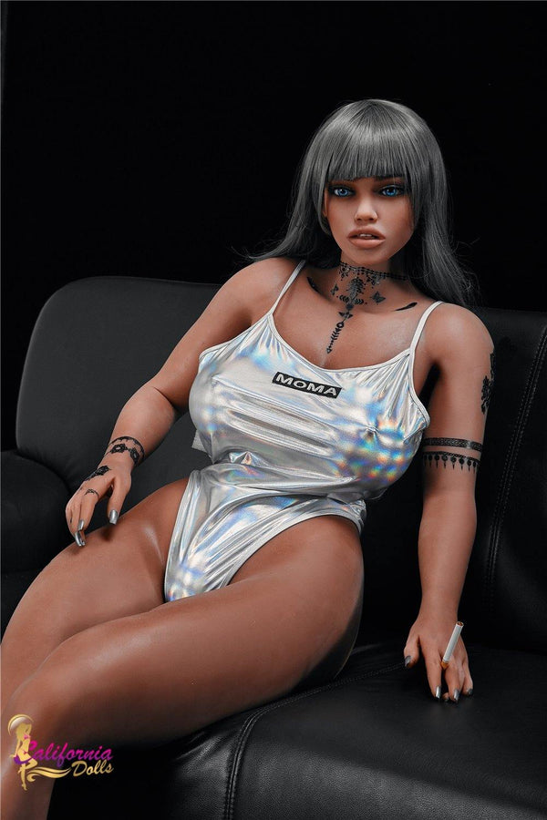 Black doll on couch in small outfit