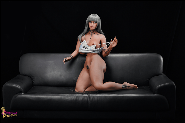 Nude black sex doll with inviting pussy.