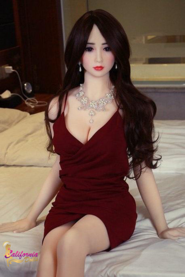 Beautiful face on slender sex doll.