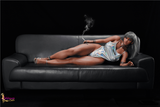 Erotic Sex Doll Black Terri Laying on a Couch