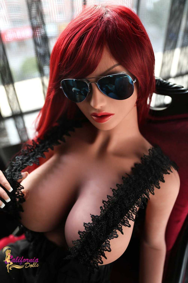 Redhead sex doll with pretty face and large tits.