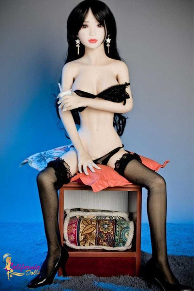 Japanese doll wearing only delightfully black lingerie.