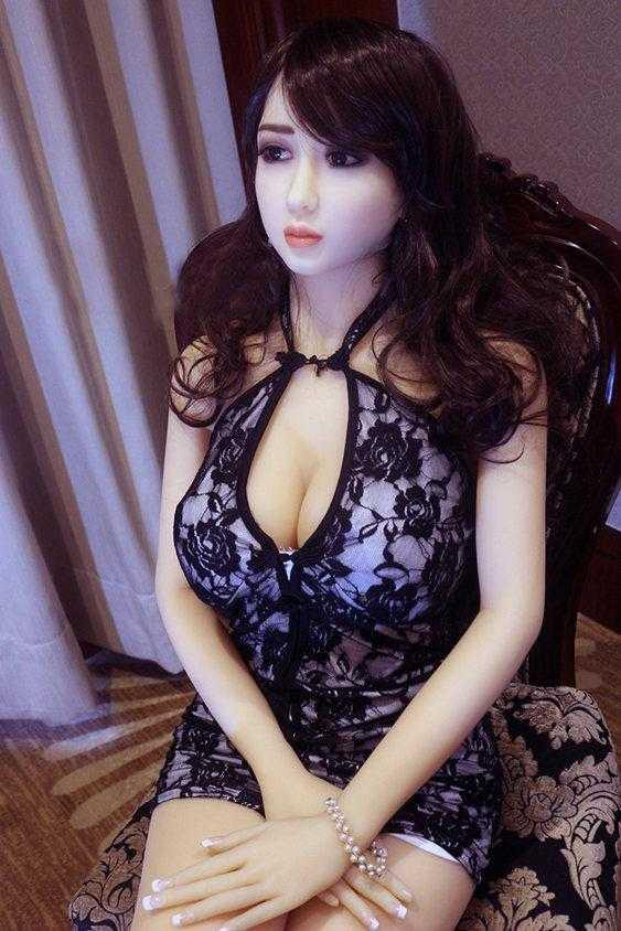 Japanese sex doll with arms crossed.