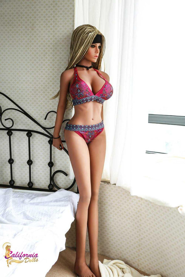 Big bust tall sex doll standing.