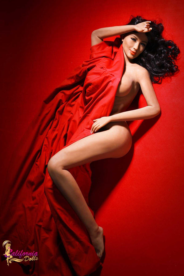 Nude Brazilian partially covered by red sheet.