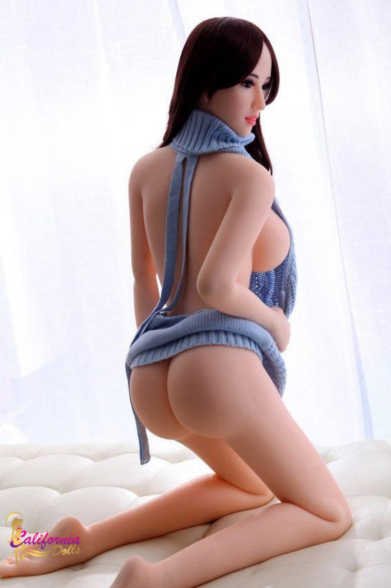 Small blue top on tall sex doll.