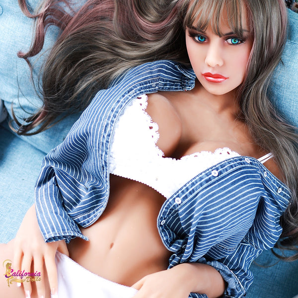 Life size sex doll with unbuttoned top and white bra.