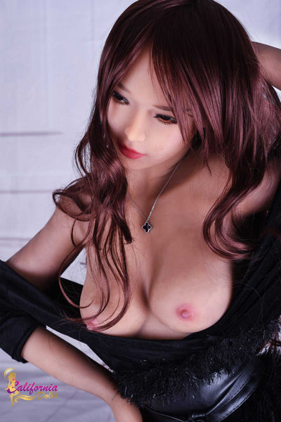Sex doll with top below small youthful breast.