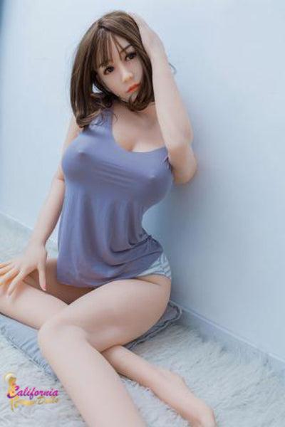 Sex doll with nipples showing through dress.