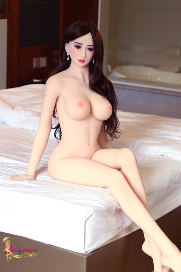 Beautiful nude sex doll with legs crossed.