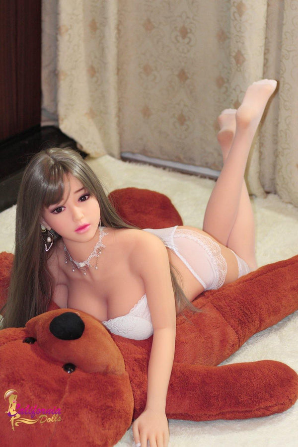 Robotic sex doll and large red Teddy bear.