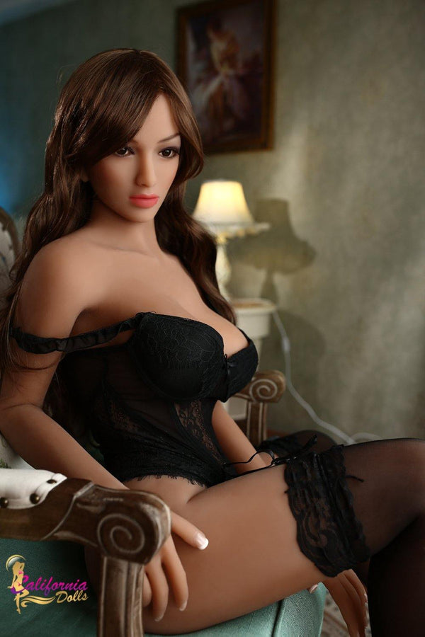 Sex doll with long wavy brown hair.