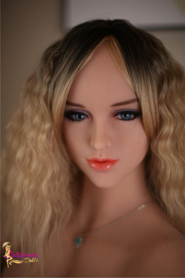 Beautiful face outlined by long wavy blonde hair.