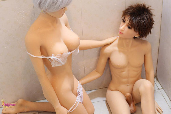 Nude male and female sex dolls together.