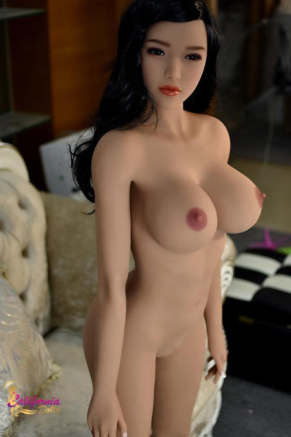 Nude  Japanese sex doll with large firm breast.