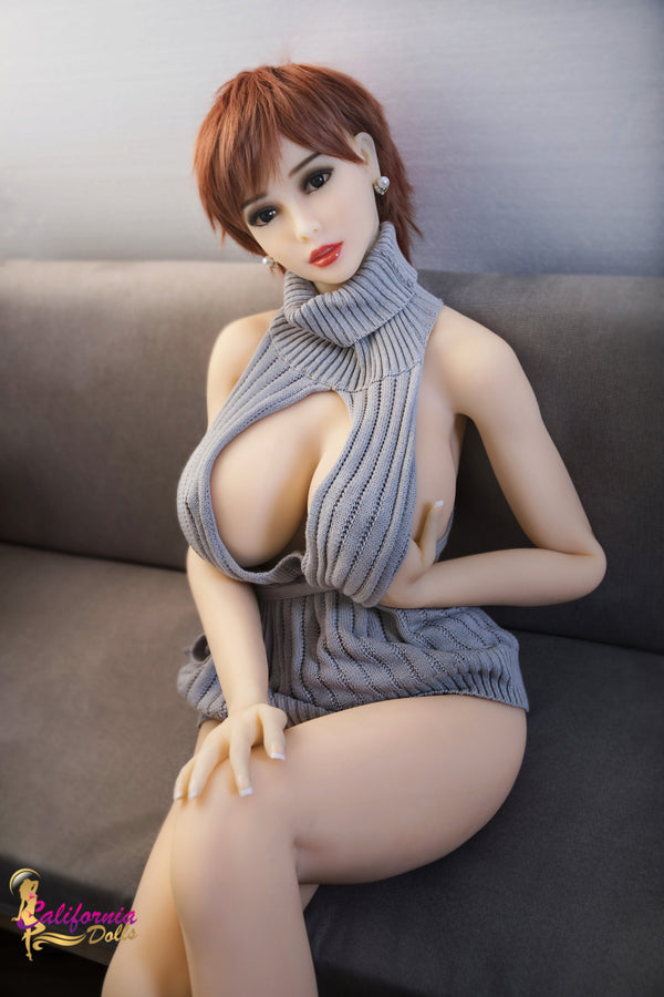 Sex doll holding big tit with hand.