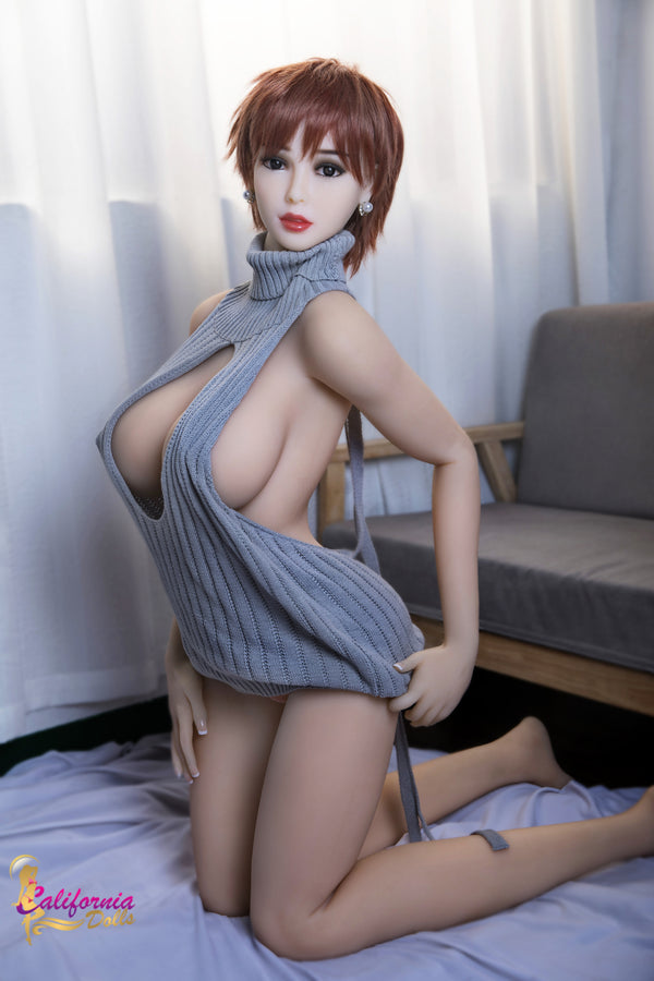Large breast sex doll on her knees.
