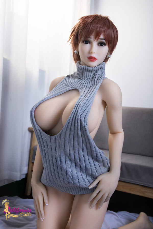 Gorgeous formed face on big boob sex doll.