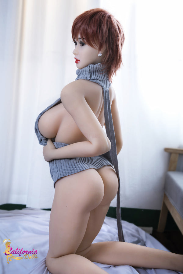 Big tits sex doll wearing small blue top.