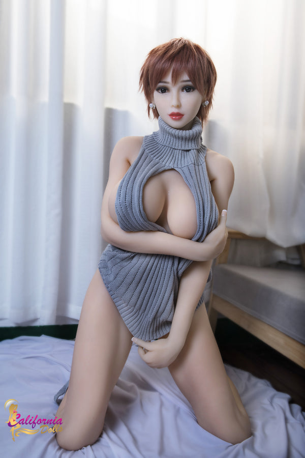 Big breast sex doll holds top over vagina.