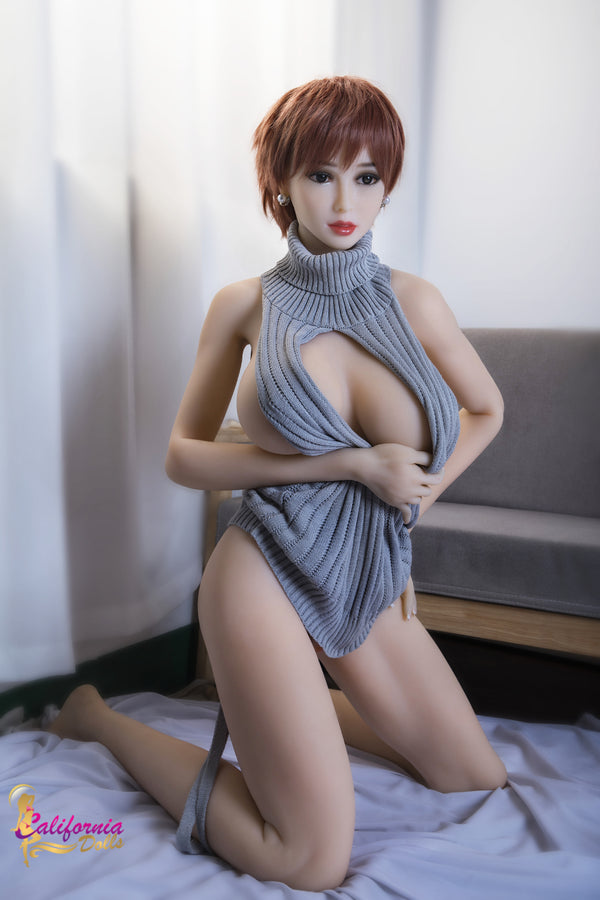 High breast sex doll holds top open.